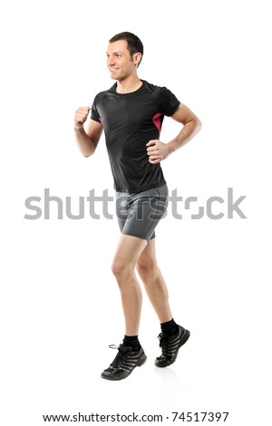 Full length portrait of a male athlete running isolated against white background