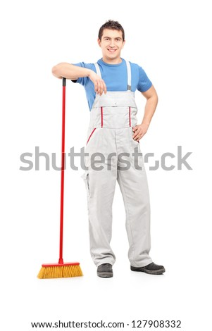 Full length portrait of a male cleaner holding a broom isolated on white background - stock photo