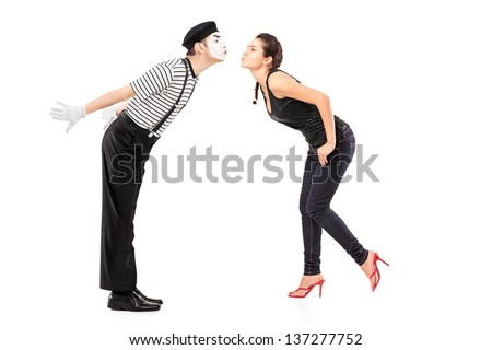 Full length portrait of a male mime artist and a young woman about to kiss isolated on white background - stock photo