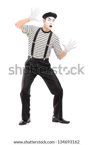 Full length portrait of a male mime artist performing, isolated on white background - stock photo