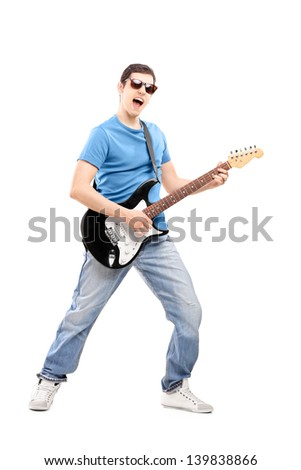 Full length portrait of a male musician playing an electric guitar, isolated on white background - stock photo