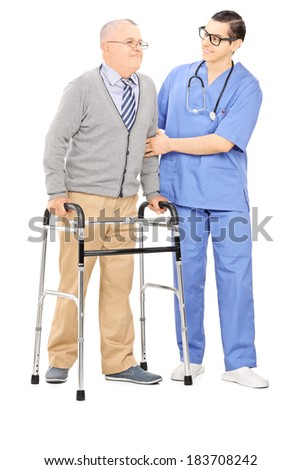 Full length portrait of a male nurse helping a senior man with walker isolated on white background - stock photo