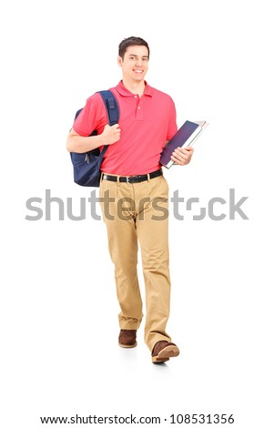 Full length portrait of a male student walking, isolated on white background - stock photo