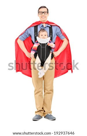 Full length portrait of a male superhero carrying his baby daughter isolated on white background - stock photo
