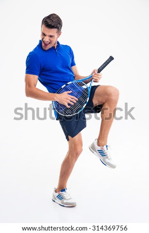 Full length portrait of a male tennis player having fun isolated on a white background - stock photo