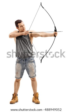 Full length portrait of a man aiming with a bow and arrow isolated on white background
