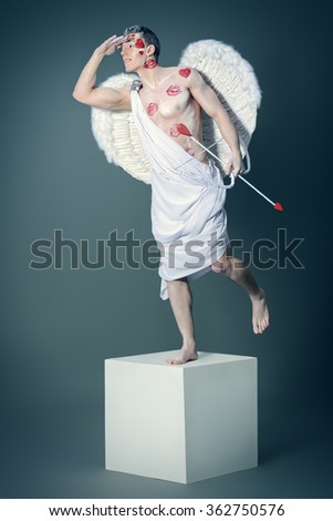 Full length portrait of a man angel Cupid posing like a statue. Valentine's day. Love concept. - stock photo