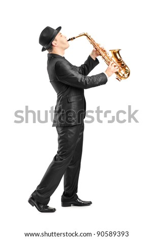 Full length portrait of a man in a suit playing on saxophone isolated against background