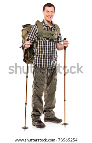 Full length portrait of a man in sportswear with backpack and hiking poles isolated on white background - stock photo