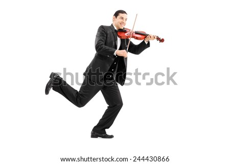 Full length portrait of a man running and playing a violin isolated on white background - stock photo