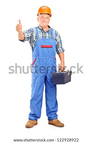 Full length portrait of a manual worker holding tool box and giving a thumb up isolated on white background - stock photo