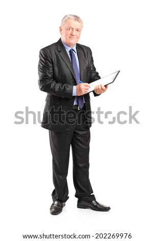 Full length portrait of a mature businessman taking notes on piece of paper isolated on white background - stock photo
