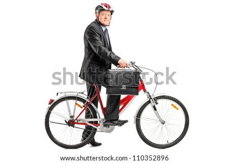 Full length portrait of a mature businessman with bicycle isolated on white background - stock photo