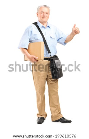 Full length portrait of a mature courier holding a package and giving thumb up isolated on white background - stock photo