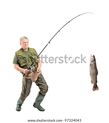 Full length portrait of a mature fisherman catching a fish isolated on white background - stock photo