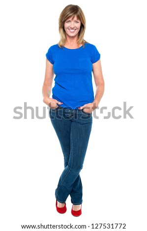 Full length portrait of a middle aged woman in trendy outfit striking stylish pose. - stock photo