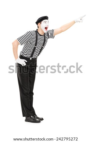 Full length portrait of a mime artist pointing up with his hand isolated on white background