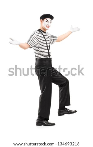 Full length portrait of a mime dancer gesturing with hands, isolated on white background - stock photo