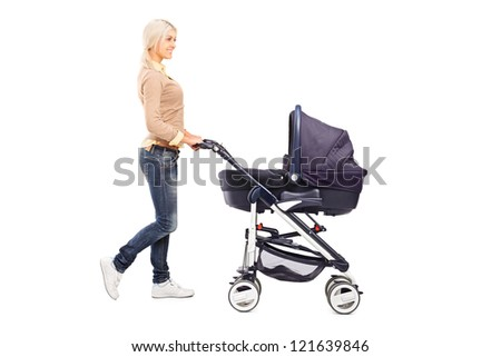 Full length portrait of a mother pushing a baby stroller isolated against white background - stock photo