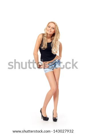 Full length portrait of a pretty smiling young woman. Isolated over white. - stock photo