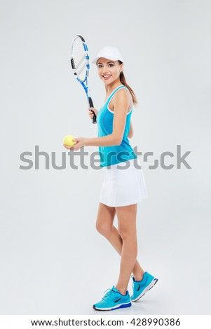 Full length portrait of a pretty woman playing in tennis isolated on a white background