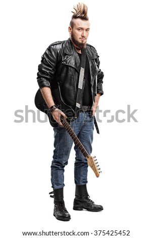 Full length portrait of a punk rock guitarist holding an electric guitar isolated on white background - stock photo
