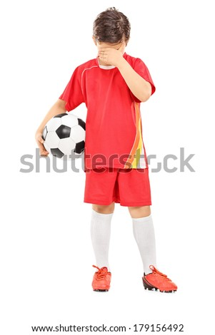 Full length portrait of a sad boy with soccer ball isolated on white background - stock photo