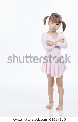 Full length portrait of a sad little ballerina dressed in pink