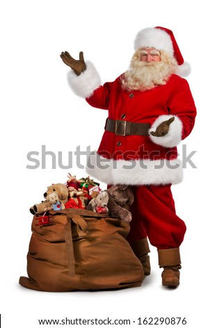 Full length portrait of a Santa Claus posing near a bag full of gifts isolated on white background - stock photo