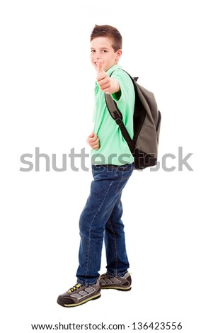 Full length portrait of a school boy with thumb up gesture, isolated on white background - stock photo