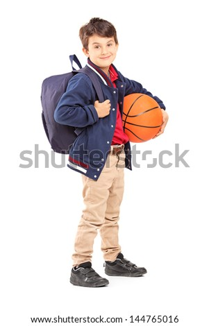 Full length portrait of a schoolboy with backpack holding a basketball, isolated on white background - stock photo