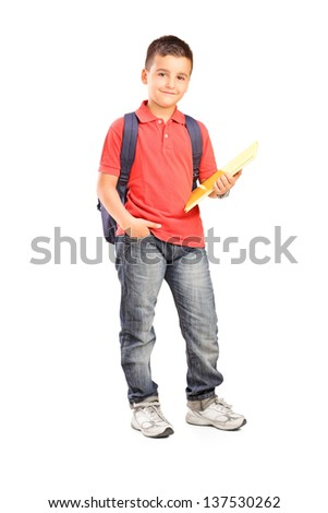 Full length portrait of a schoolboy with backpack holding a notebook isolated on white background - stock photo