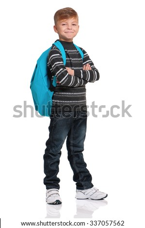 Full length portrait of a schoolboy with backpack, isolated on white background  - stock photo
