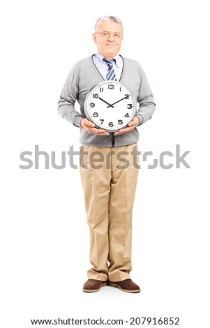 Full length portrait of a senior gentleman holding a big wall clock isolated on white background - stock photo