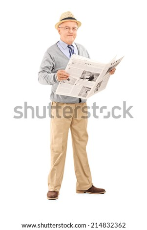Full length portrait of a senior gentleman holding a newspaper and looking at the camera isolated on white background - stock photo