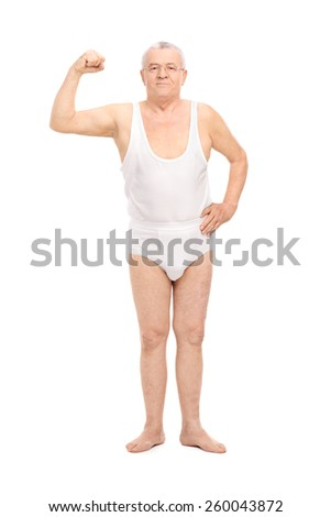 Full length portrait of a senior in underwear showing bicep isolated on white background - stock photo