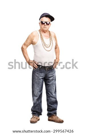 Full length portrait of a senior man in hip-hop clothes looking at the camera isolated on white background - stock photo