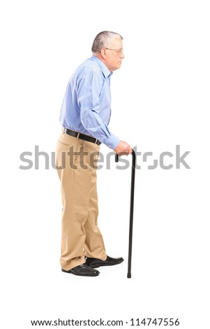 Full length portrait of a senior man walking with a cane isolated on white background - stock photo