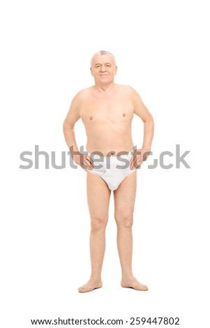 Full length portrait of a senior posing in white underwear isolated on white background - stock photo