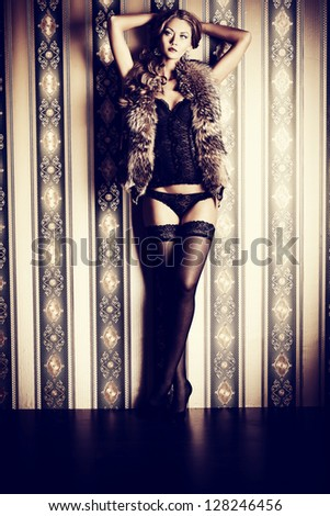 Full length portrait of a sexual fashionable woman over vintage background. - stock photo