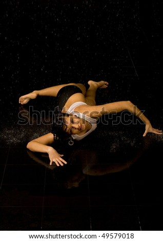Full length portrait of a sexy woman in water studio - stock photo
