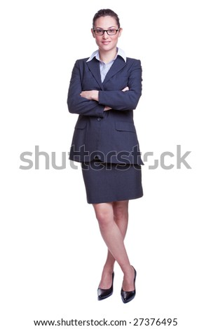 Full length portrait of a smiling businesswoman wearing a skirted suit, isolated on white background.
