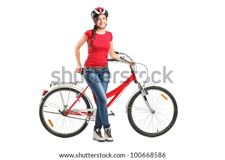 Full length portrait of a smiling female posing next to a bicycle isolated on white background - stock photo
