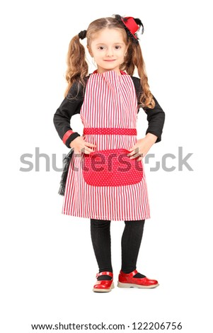 Full length portrait of a smiling girl wearing apron and posing isolated against white background - stock photo