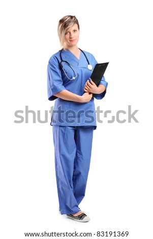 Full length portrait of a smiling healthcare professional holding a clipboard isolated on white background - stock photo