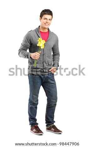 Full length portrait of a smiling male holding flowers and waiting for somebody to come isolated on white background - stock photo