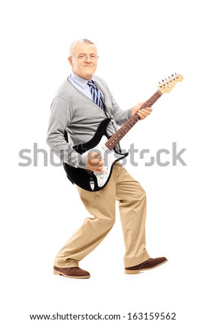 Full length portrait of a smiling senior man playing guitar isolated on white background