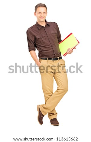 Full length portrait of a smiling student leaning against wall isolated on white background