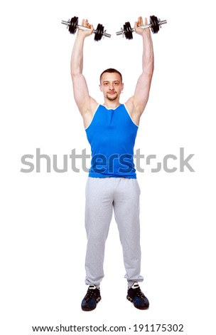 Full-length portrait of a sports man doing exercises with dumbbells over white background