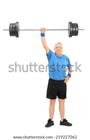 Full length portrait of a strong senior holding a weight in one hand isolated on white background - stock photo